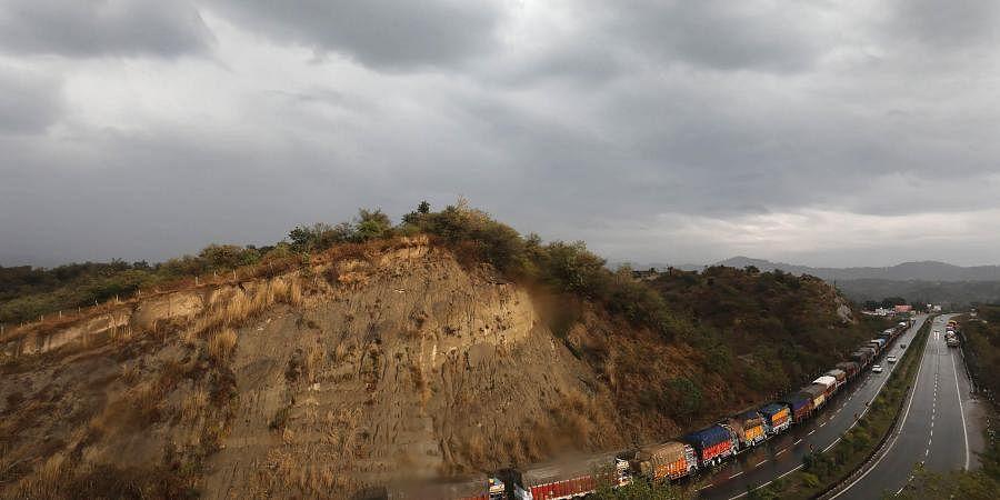 Stranded trucks along the Jammu-Srinagar national highway. (Photo| PTI)