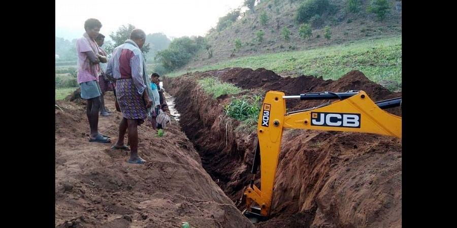 Tribal farmers of Sarika, Varaka and Chintalavalasa restore a defunct irrigation canal on their own. (Photo   Express)