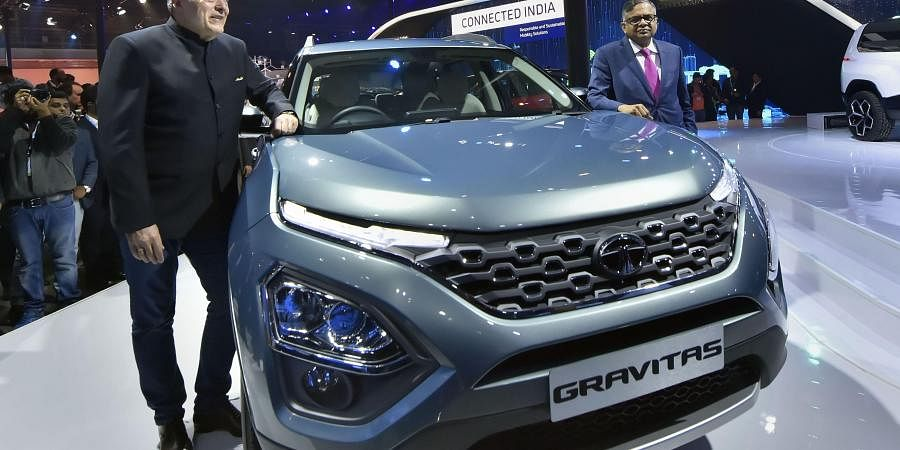 Tata Sons Chairman N Chandrasekaran (L)) unveils the Tata Gravitas in the SUV segment, at the Auto Expo 2020 in Greater Noida