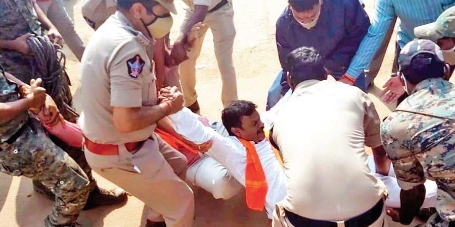 Police take BJP MLC PVN Madhav into custody at Ramatheertham in Vizanagaram district.