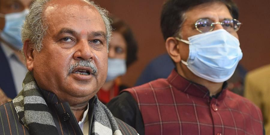 Union Minister for Agriculture & Farmers Welfare Narendra Singh Tomar (L) addresses media after the 8th round of talks between the farmer leaders and the Centre