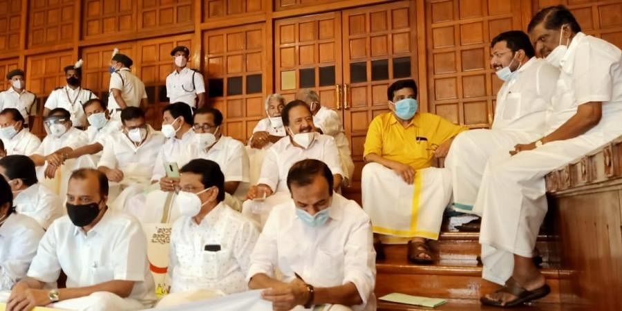 Opposition MLAs protesting inside Kerala Assembly premise after boycotting the Governor's policy address. (Photo   Vincent Pulickal, EPS)