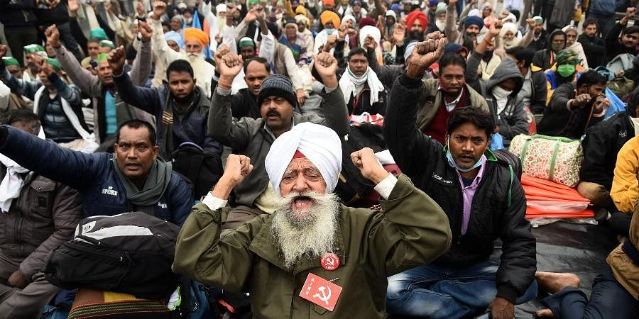 Farmers during their protest against the new farm laws at the Ghazipur border in New Delhi.