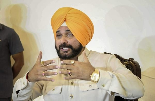 'All issues resolved': Sidhu to rescind resignation after meet with Rahul, continue asPunjab Cong chief