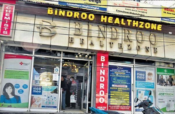 10 daysafter militants gunned down Srinagar chemist, kin reopens pharmacy