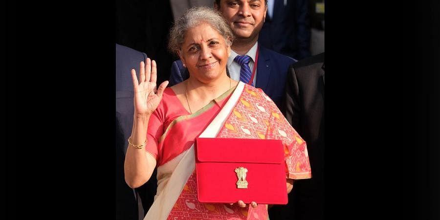 Finance Minister Nirmala Sitharaman holds a folder case containing the Union Budget 2021-22 in Delhi. (Photo | Shekhar Yadav, EPS)