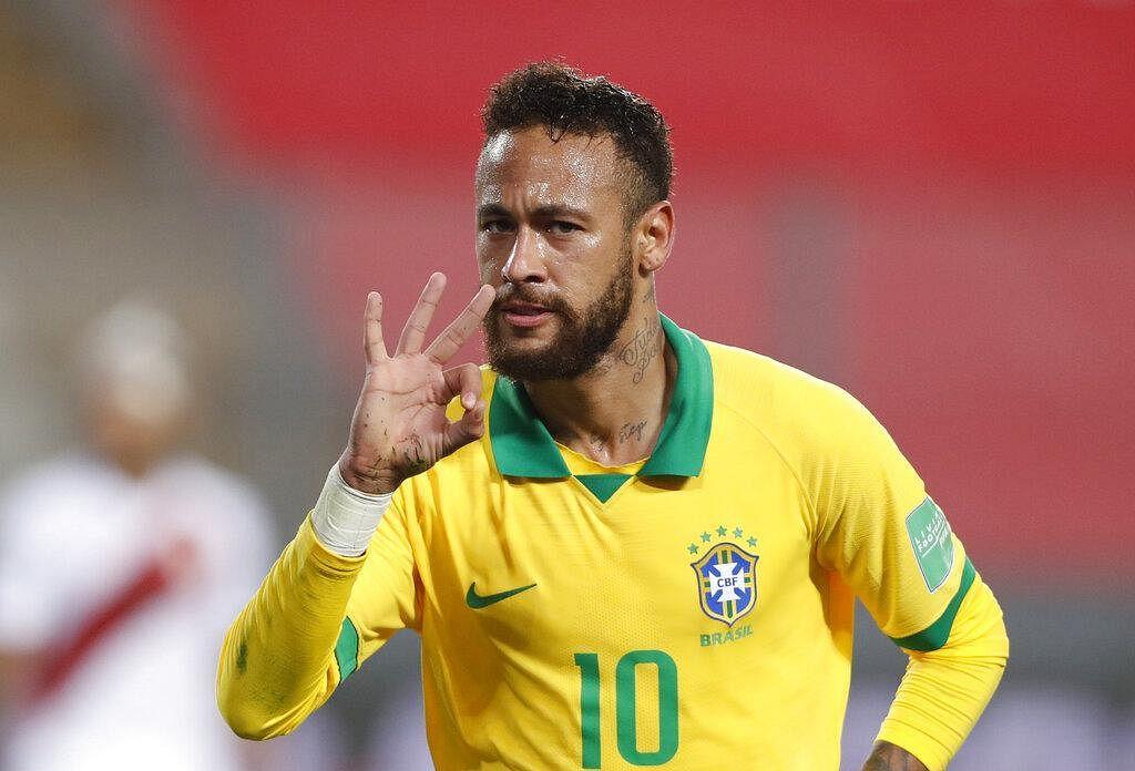 Brazil's Neymar celebrates scoring his third goal against Peru.