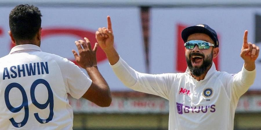 India's Ashwin and Virat Kholi celebrate the dismissal of England's Rory Burns during the 4th day of the first test matchat MA Chidambaram Stadium, in Chennai.