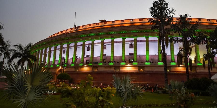 An illuminated Parliament House building during the ongoing Budget Session in New Delhi Wednesday