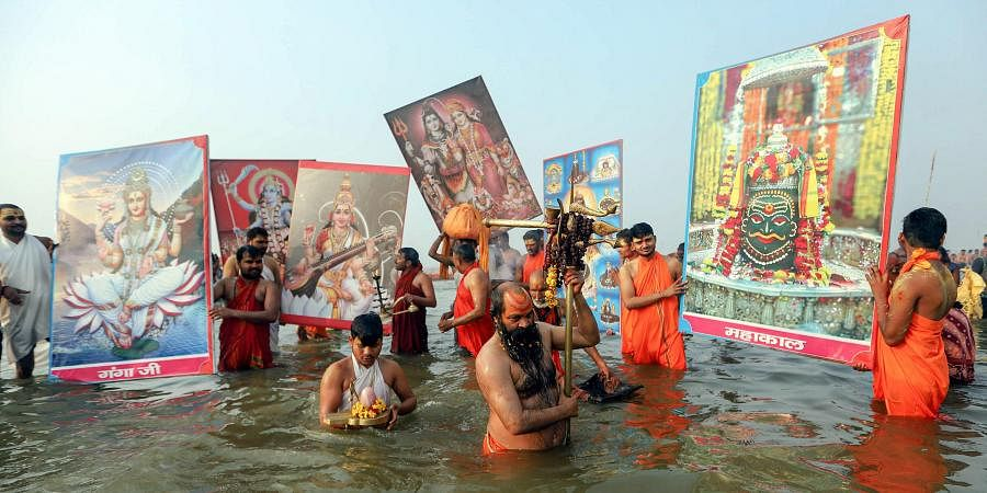 Sadhus offer prayers after taking a holy dip at Sangam confluence of River Ganga Yamuna and Saraswati on 'Mauni Amavasya' during the ongoing annual 'Magh Mela' festival in Prayagraj