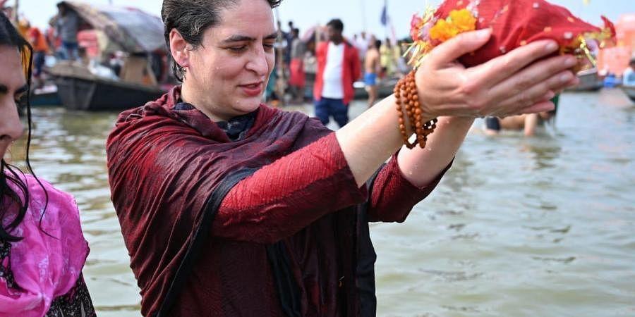 Priyanka Gandhitakes holy dip in Sangam. (Photo| Twitter/ Congress)