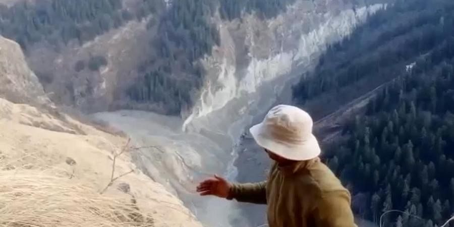 Geologist Naresh Rana points to the site of lake formation.