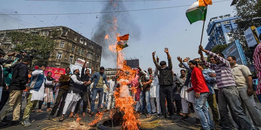Congress activists burn a tyre to block a road during their 'Bangla Bandh' protest over Thursday's alleged police attack on their party rally in Kolkata Friday