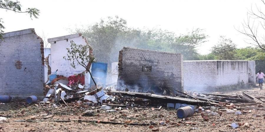A view of the working sheds seen damaged following the blast that was triggered at a cracker unit at Achankulam  village near Sattur in Virudhunagar district. (Photo | EPS)