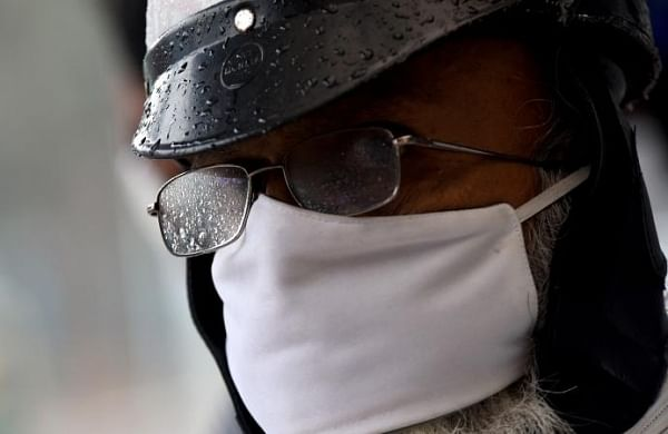Researchers propose that humidity from masks may lessen severity of COVID-19- The New Indian Express