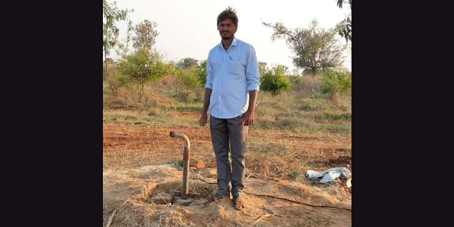 A  family member pose with the new borewell that got water in Meti's farm in Koppal district recently. (Photo | EPS)