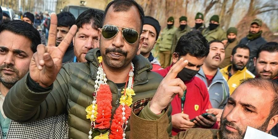 Independent candidate Shabir Ahmad flashes victory sign after his lead in the District Development Council DDC election results in Srinagar Tuesday Dec. 22 2020.