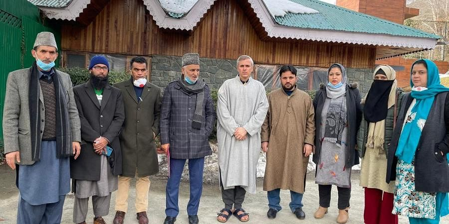 NC leader Omar Abdullah with 8 DDC members of  his party after an Independent was elected head  of a 14-strong council in Budgam