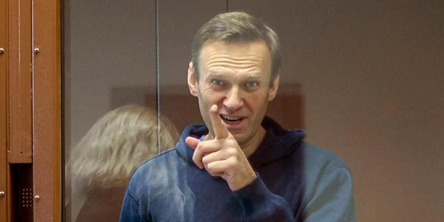 Russian opposition leader Alexei Navalny gestures during a hearing on his charges for defamation in the Babuskinsky District Court in Moscow