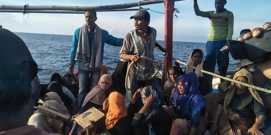 A vessel carrying Rohingya people some eight kilometres offshore in the Malacca strait between Indonesia and neighbouring Malaysia.