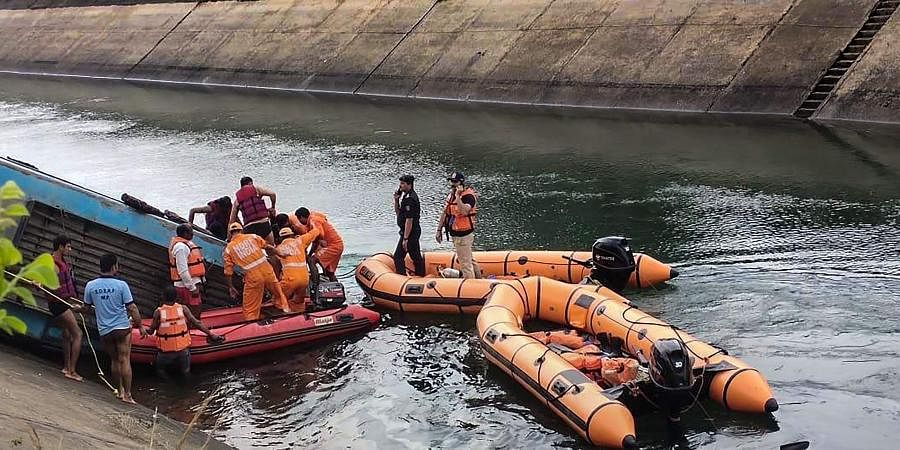 NDRF team carries out rescue operation after an overcrowded bus plunged into a canal in Sidhi district of Madhya Pradesh. (Photo| PTI)