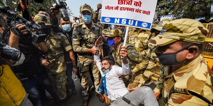 Police detain NSUI activists who were staging a protest against the arrest of climate activist Disha Ravi, in New Delhi