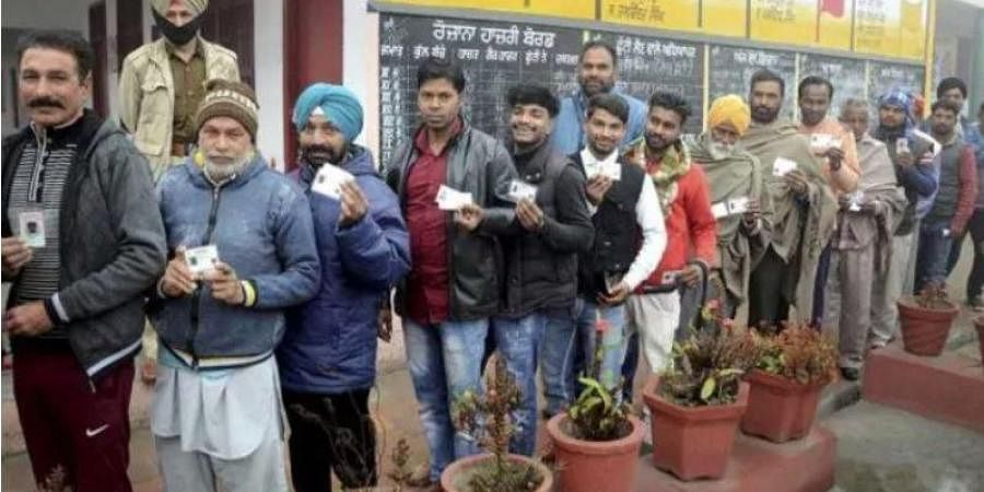 Electors in queue to vote in the Punjab Municipal Election 2021.