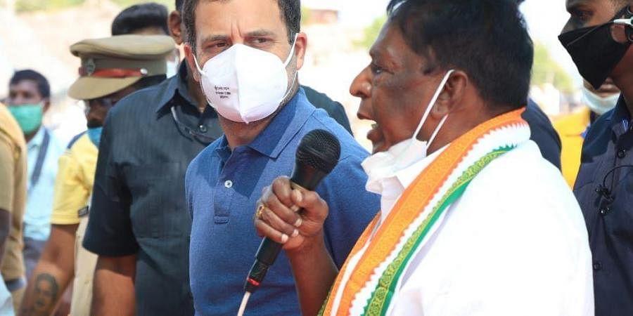 Congress leader Rahul Gandhi and Pondicherry chief minister V Narayanasamy interact with fishing community in Puducherry.