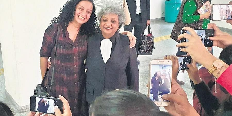 Priya Ramani and her lawyer Rebecca John after the court's verdict.