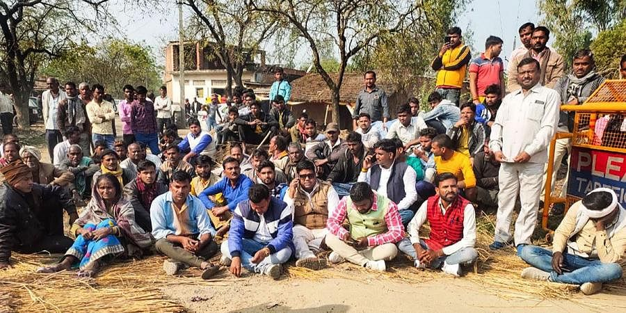 Locals stage a protest after bodies of two minor Dalit girls were found in a field and another in critical condition, near Baburaha village in Unnao district. (Photo | PTI)