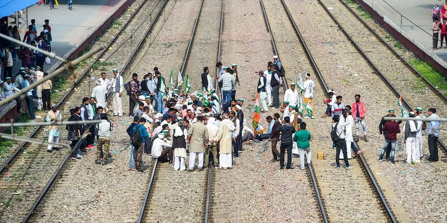 Members of various farmer organisations block a railway track in Sonipat during a four-hour 'rail roko' demonstration across the country