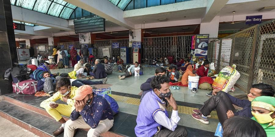 Passengers stranded at Anand Vihar Railway Station due to  'rail roko' demonstration called by Samyukta Kisan Morcha as part of their agitation against Centre's farm reform laws in New Delhi Thursday.
