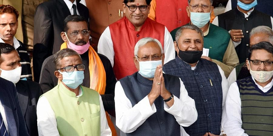 Bihar CM Nitish Kumar along with legislators arrives at Bihar Assembly, during the first day of Budget Session, in Patna.