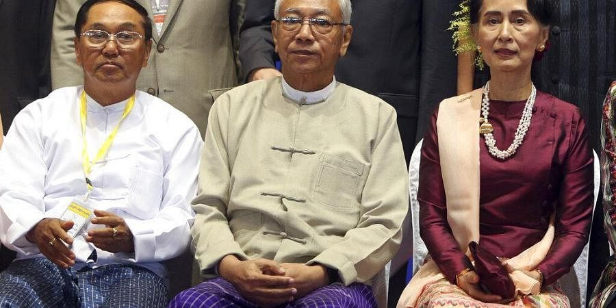 Myanmar's Vice President Myint Swe, left, sits with State Counsellor Aung San Suu Kyi, right, and then President Htin Kyaw, pose for a photo session. (Photo | AP)