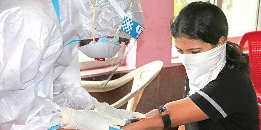 RMRC staff collect blood sample of a woman during the ongoing sero survey in Bhubaneswar  | IRFANA