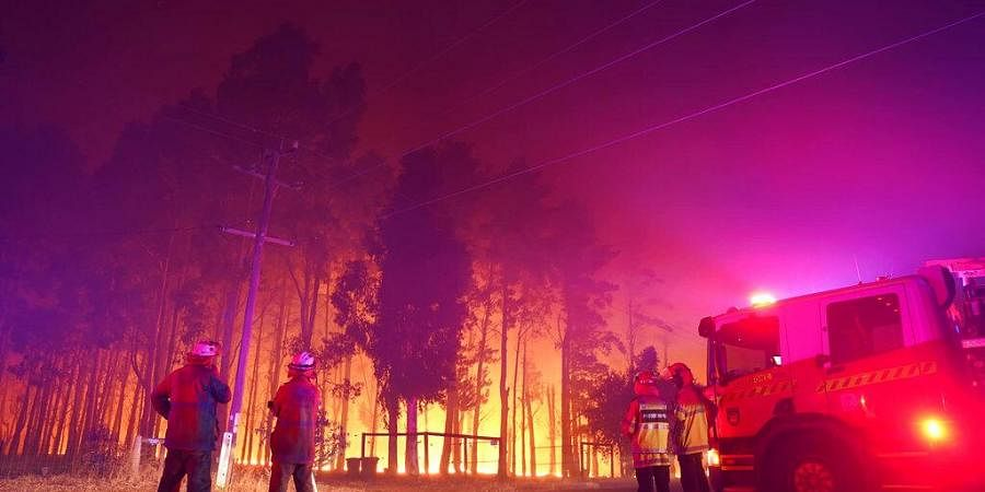 Firefighters attend a fire at Wooroloo, near Perth, Australia, Monday, Feb. 1, 2021. (Photo | AP)