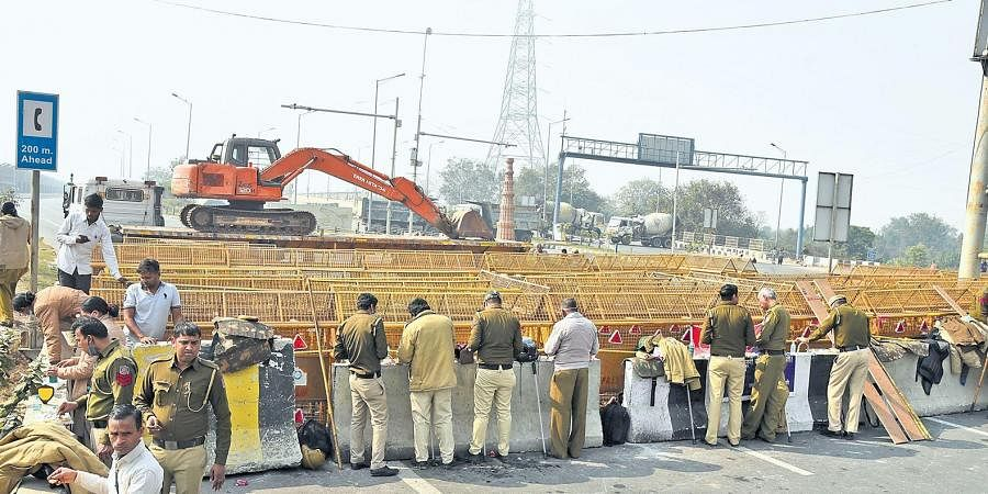 Barricades being strengthened near Akshardham to stop farmers from marching towards the national capital to protest against the farm reform laws, in New Delhi.