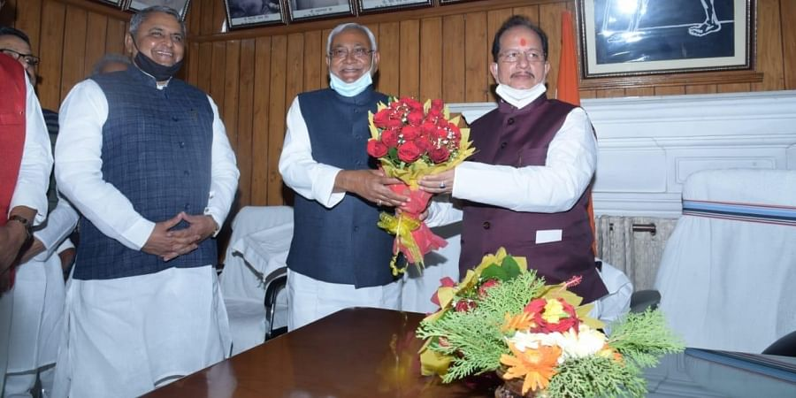 CM Nitish Kumar being greeted by speaker on the first day of budget session of Bihar Assembly.