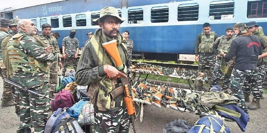 Paramilitary personnel arrive at Chitpur Yard in Kolkata on Saturday.