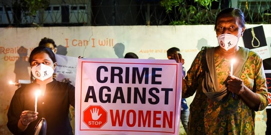 Lawyers display a placard to condemn the gang-rape and murder of a Dalit woman in Uttar Pradesh. (Photo  AFP)