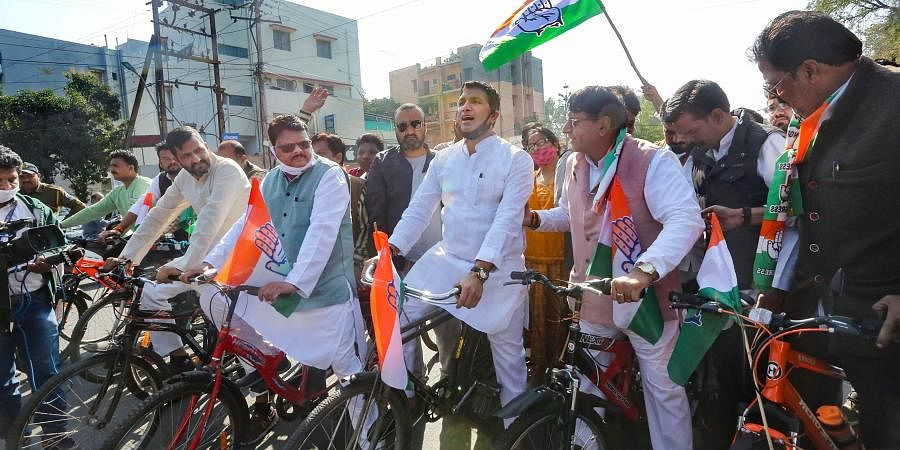 Congress MLAs ride bicycles as they stage a protest against the hike in fuel price. (Photo| PTI)