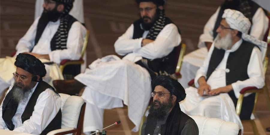 Taliban co-founder Mullah Abdul Ghani Baradar, bottom right, speaks at the opening session of peace talks between the Afghan government and the Taliban in Doha, Qatar.