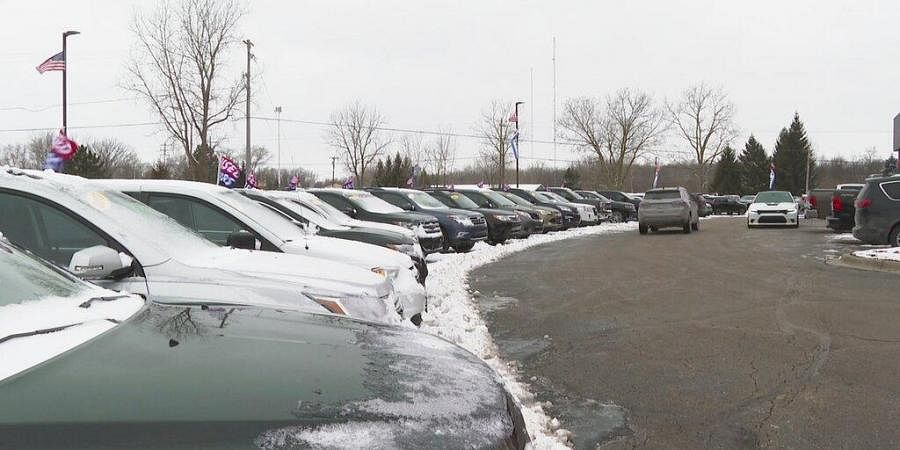 In this image made from video, cars drive through the used vehicle lot at a LaFontaine auto dealership in Fenton Township, Mich. (Photo | AP)