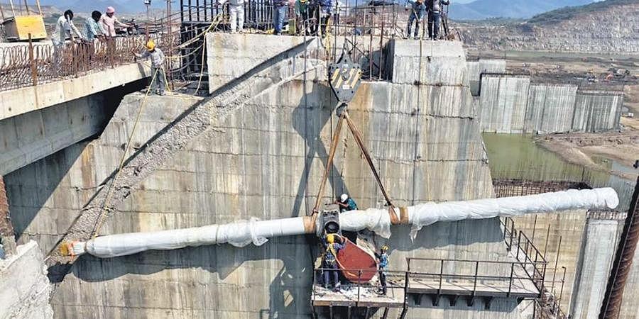 Hydraulic cylinder fixed to Polavaram radial gate on Monday.