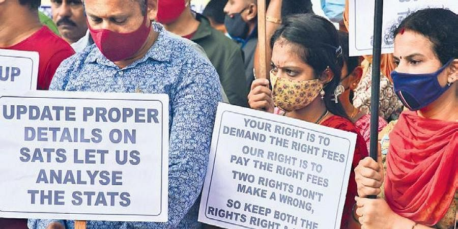 Parents stage a protest in Bengaluru on Sunday demanding that Education Minister S Suresh Kumar regulate school fees of privatye schools