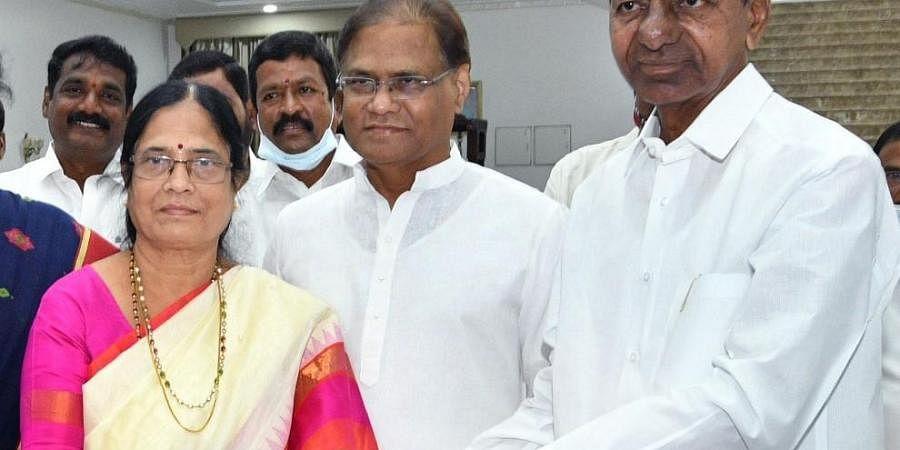 CM Chandrasekhar Rao hands over B-Form to Vani Devi on Monday.