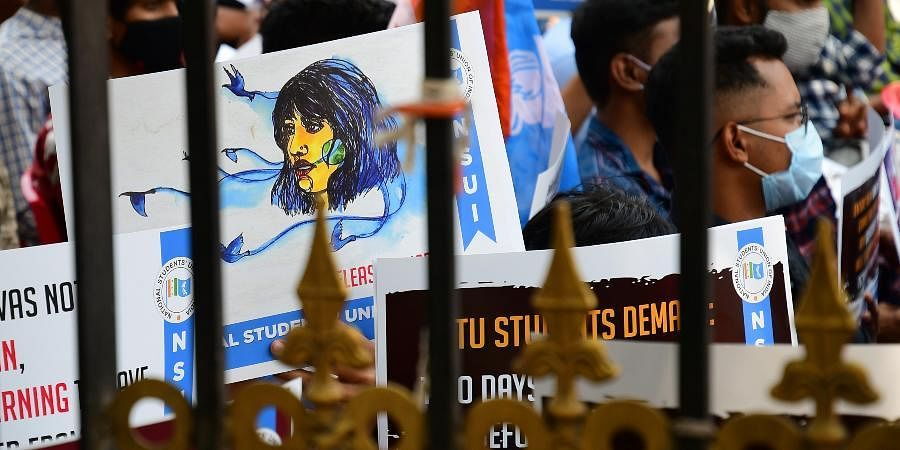 Students and members of NSUI display placards during a protest to condemn the arrest of climate activist Disha Ravi.