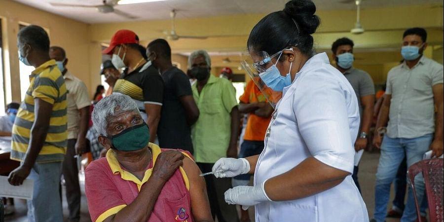 A Sri Lankan nurse administers COVID-19 vaccine to a municipal worker in Colombo, Sri Lanka, Tuesday, Feb. 16, 2021. (Photo | AP)