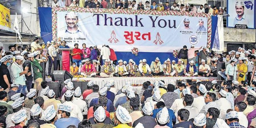 Aam Aadmi Party candidates and workers celebrate after winning multilple seats in the Surat Municipal Corporation polls