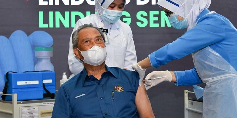 Malaysia's Prime Minister Muhyiddin Yassin receiving the first dose of the Pfizer/BioNTech Covid-19 vaccine.(Photo| AFP)